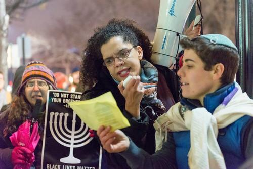 April Baskin at a Black Lives Matter Hanukkah Action