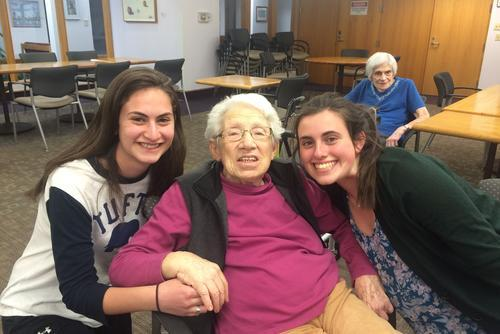 Elderly woman with two teenage girls