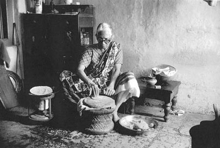 Woman Baking Bread in Bombay