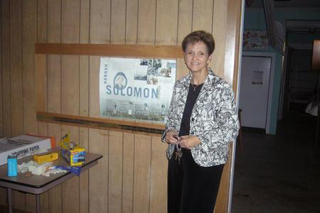 Carol Wise Beside JWA Poster in the Abandoned Congregation Beth Israel in Biloxi, June 21, 2007
