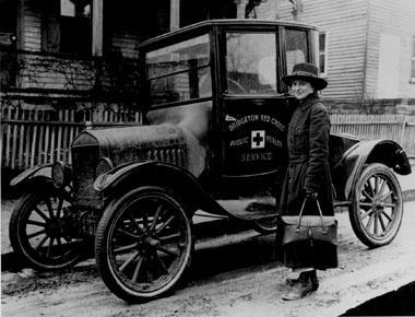A Red Cross Public Health Nurse with her Model T Ford